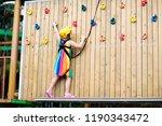 child in forest adventure park. ... | Shutterstock . vector #1190343472