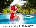 child in swimming pool.... | Shutterstock . vector #1190343475