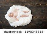 baby lying on white soft... | Shutterstock . vector #1190345818