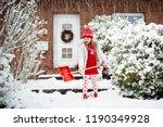 child shoveling snow. little...   Shutterstock . vector #1190349928