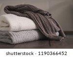 stack of neatly folded woolen... | Shutterstock . vector #1190366452