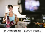 female vloggers making video at ... | Shutterstock . vector #1190444068
