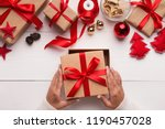 time to open presents. female... | Shutterstock . vector #1190457028