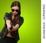 woman aiming with gun against a ... | Shutterstock . vector #119046562