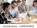 diversity colleagues sitting... | Shutterstock . vector #1190524042