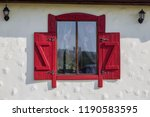 an antique painted wooden... | Shutterstock . vector #1190583595