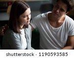 unhappy couple. guy calms... | Shutterstock . vector #1190593585