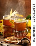 two glasses of hot tea an... | Shutterstock . vector #1190810515