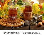 two glasses of hot tea an... | Shutterstock . vector #1190810518