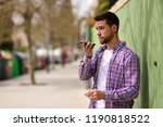 young man recording voice note... | Shutterstock . vector #1190818522
