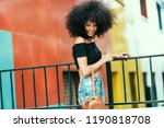 young mixed woman with afro... | Shutterstock . vector #1190818708