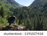 hiker tying hist boot on the... | Shutterstock . vector #1191027418
