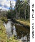 creek winding through fall... | Shutterstock . vector #1191035482