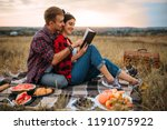 couple reads book together ... | Shutterstock . vector #1191075922