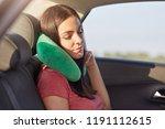 female passenger sleeps in car... | Shutterstock . vector #1191112615