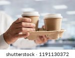 businessman carrying coffee... | Shutterstock . vector #1191130372