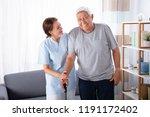 female caretaker assisting... | Shutterstock . vector #1191172402