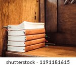 Stack Of Songbooks On A Wooden...