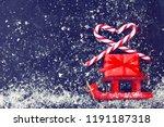 christmas red sleds carry gift...   Shutterstock . vector #1191187318