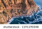 winding road cutting through a... | Shutterstock . vector #1191190348