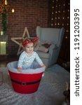 beautiful baby on christmas...   Shutterstock . vector #1191203395