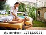 massage   woman receiving back... | Shutterstock . vector #1191230338