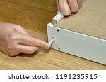 assembling furniture  the... | Shutterstock . vector #1191235915
