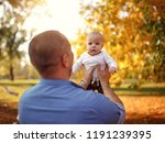 young father with baby in park | Shutterstock . vector #1191239395