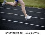 Runner running a race around a track with  lines - stock photo