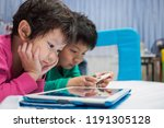 two chinese children addicted... | Shutterstock . vector #1191305128