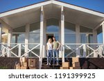 couple standing on steps on new ... | Shutterstock . vector #1191399925
