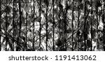 Small photo of Green leave and tree on stainless steel fence with sunlight for background in black and White style - Beauty of Nature, Wallpaper and Art concept