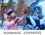 kid girl helping to clean car... | Shutterstock . vector #1191445252