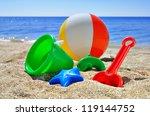 Baby Toys On The Beach Sand...