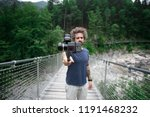 video or filmmaker stands in... | Shutterstock . vector #1191468232