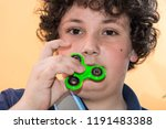 boy playing with fidget spinner ... | Shutterstock . vector #1191483388