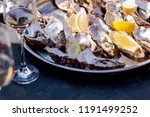 opened oysters on a plate and... | Shutterstock . vector #1191499252