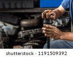 car mechanic or serviceman... | Shutterstock . vector #1191509392