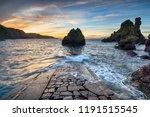 dramatic sunset over sea stacks ... | Shutterstock . vector #1191515545