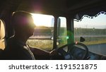 man driving a truck and... | Shutterstock . vector #1191521875