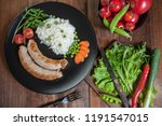 grilled sausages on plate with... | Shutterstock . vector #1191547015