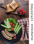 grilled sausages on plate. raw... | Shutterstock . vector #1191547042