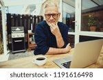 smiling senior man enjoying a... | Shutterstock . vector #1191616498