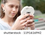 young girl with a phone | Shutterstock . vector #1191616942