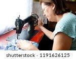 mature woman sewing | Shutterstock . vector #1191626125