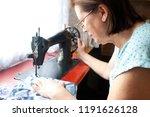 mature woman sewing | Shutterstock . vector #1191626128