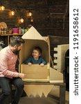 kid happy sit in cardboard hand ...   Shutterstock . vector #1191658612