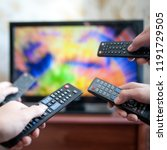 four people with tv controllers | Shutterstock . vector #1191729505