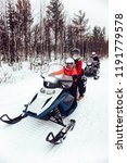 women and man on snowmobile in... | Shutterstock . vector #1191779578