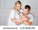 happy parents holding a cute... | Shutterstock . vector #1191808198